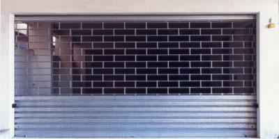 Serrande e porte per garage serranda inox roma for Serrande avvolgibili per garage prezzi